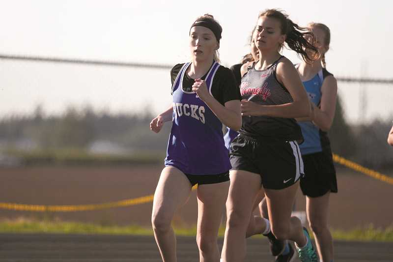 PHIL HAWKINS - St. Paul's Presley Smith (left) and Kennedy's Mikayla Schaecher helped make the Bucks and Trojans girls track teams  two of the top academic 2A programs in the state.