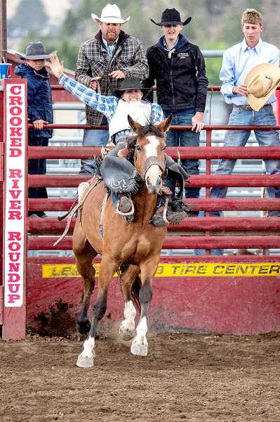LON AUSTIN - Chase Buchananm, who attends Culver High School the sadle bronc riding championship.