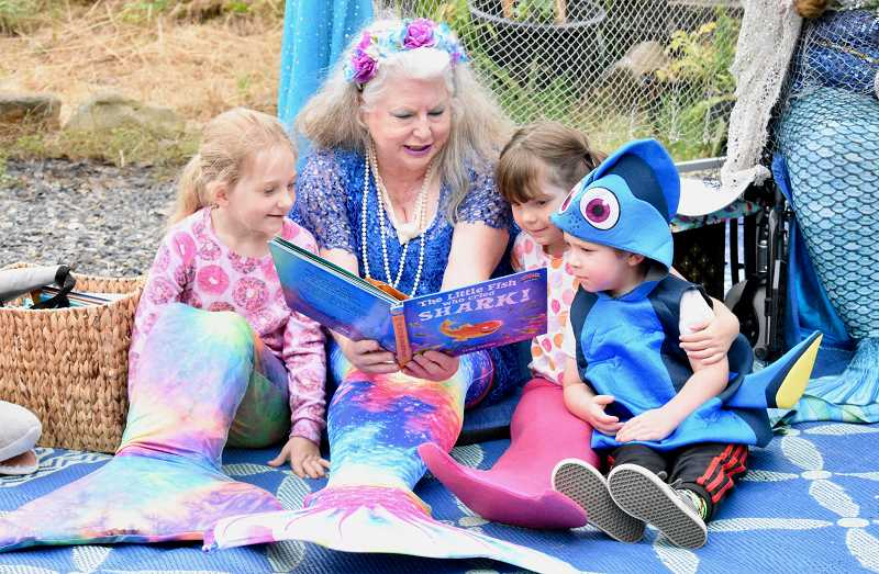 OUTLOOK PHOTO: CHRISTOPHER KEIZUR - Mermaid Storytime was a popular event during SnowCap Community Charities thank you barbecue.