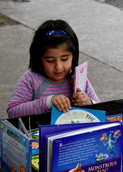 OUTLOOK PHOTO: CHRISTOPHER KEIZUR - Children who were at the celebration could pick out books to take home.