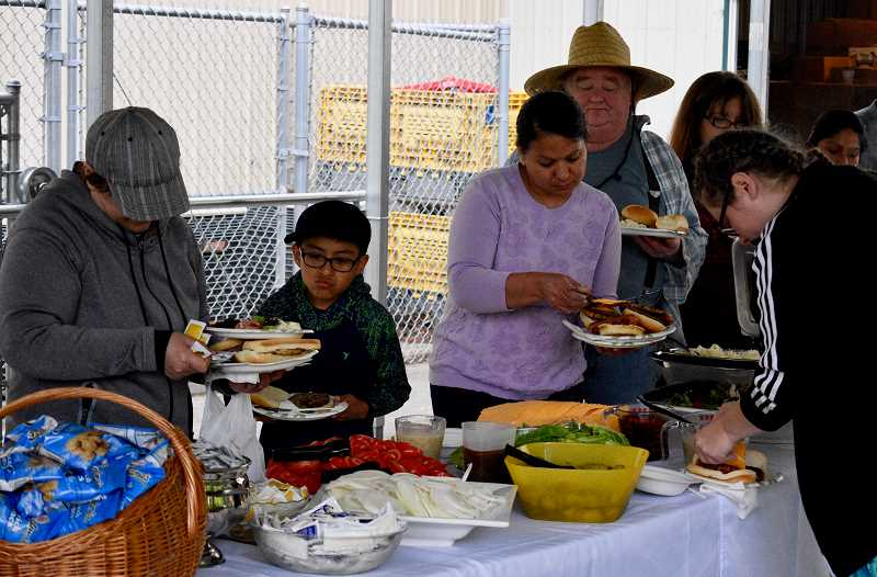 OUTLOOK PHOTO: CHRISTOPHER KEIZUR - The barbecue event was a way to do something special for the many neighbors who rely on the food pantry every month.