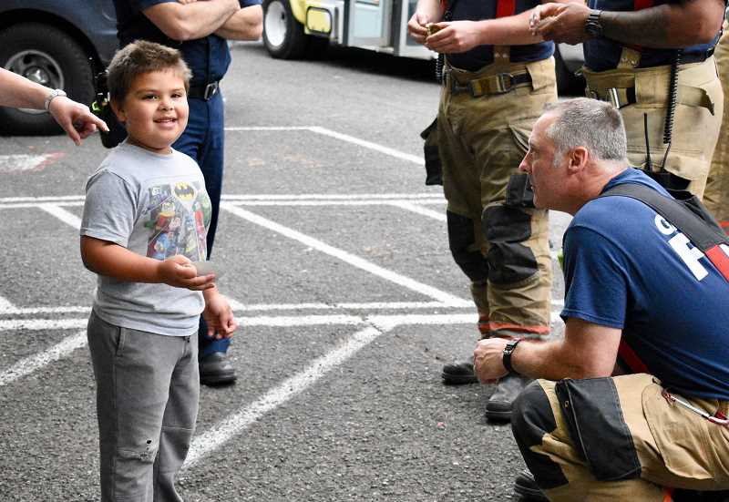 OUTLOOK PHOTO: CHRISTOPHER KEIZUR - Owen, 6, spoke with the Gresham firefighters at the cookout. He told them about his dreams to be a zookeeper.