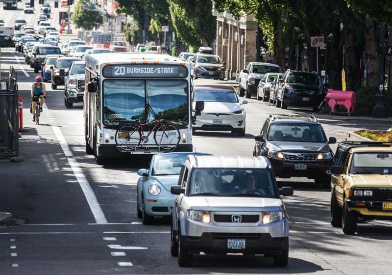 JONATHAN HOUSE/PAMPLIN FILE PHOTO - A TriMet bus goes up East Burnside during afternoon rush hour in Portland Aug. 18, 2017.