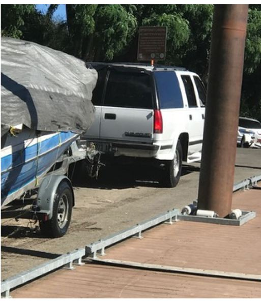 PHOTO COURTESY: CLACKAMAS COUNTY SHERIFFS OFFICE - The suspect vehicle in the act of dumping the boat full of trash.