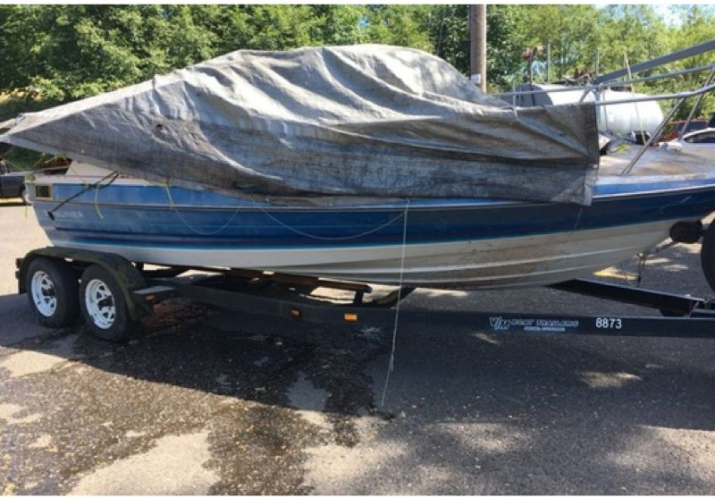 PHOTO COURTESY: CLACKAMAS COUNTY SHERIFFS OFFICE - A boat filled with trash was found abandoned in the Willamette River in Oregon City on June 24.