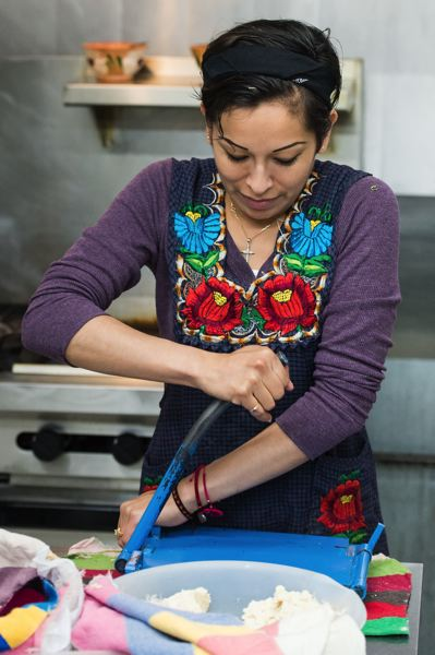 STAFF PHOTO: CHRISTOPHER OERTELL - Lucia Silva of Hillsboro has been enrolled in Adelante Mujeres and the City of Hillsboro's Cocinemos program, which helps entrepreneurs succeed in food-based business. The program previously used Forest Grove and Hillsboro senior center kitchens.