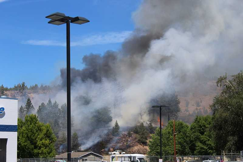 JASON CHANEY/CENTRAL OREGONIAN - Fire burns the hill north of Robberson Ford.