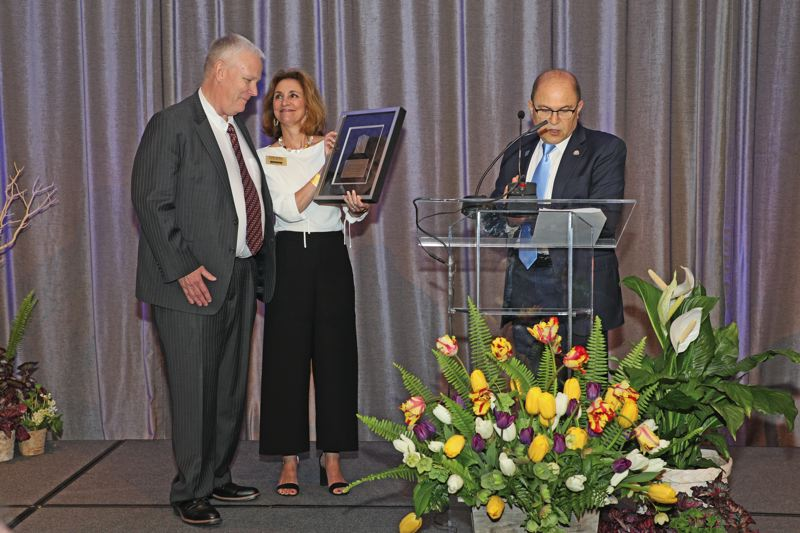 COURTESY: PMAR - Bill Russell (left) receives the 2018 PMAR First Citizen award. Russell leads the Union Gospel Mission, which serves over 250,000 meals per year to the homeless and hungry.
