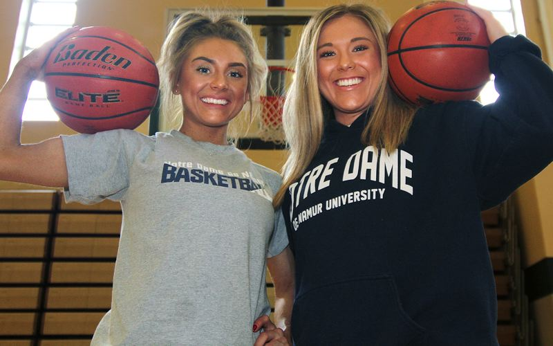 TIDINGS PHOTO: MILES VANCE - West Linn's Courteney (left) and Brooke Landis took wildly different routes but ended up in the same place — college basketball at Notre Dame de Namur University.