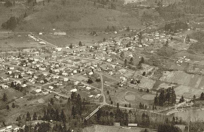 OLD OREGON PHOTOS - West Linn's Willamette neighborhood in the 1960s, prior to the arrival of I-205. Note Willamette Park on bottom right and Tannler's Dairy on the top left of the photo.