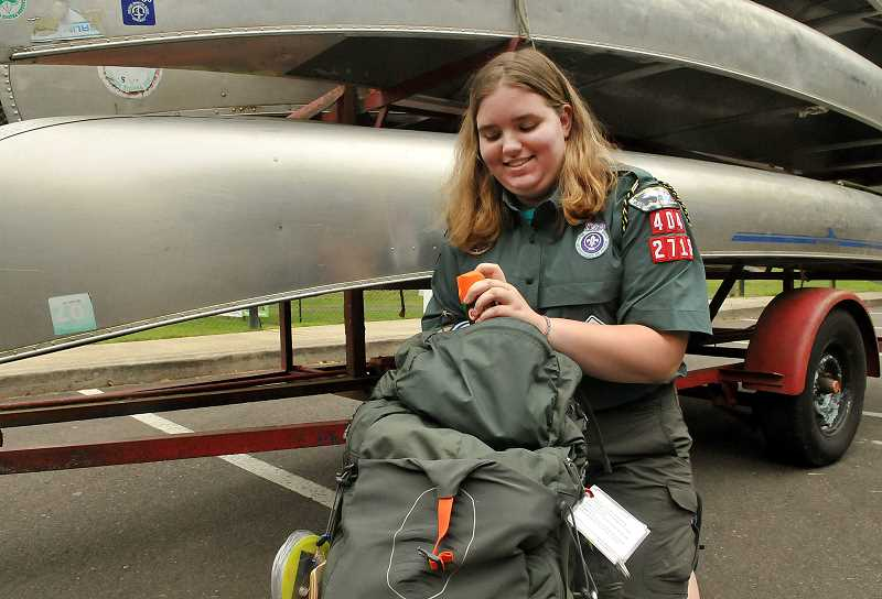 Julianna Cimral has long dreamed of participating in Boy Scout activities, and now she has her chance. Here, she prepares for a weekend camping trip.