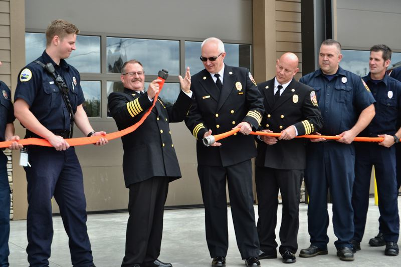 POST PHOTO: BRITTANY ALLEN - Fire Chief Phil Schneider led the department in a nontraditional 'ribbon cutting' ceremony for the grand reopening of the Sandy Fire Station on June 23.