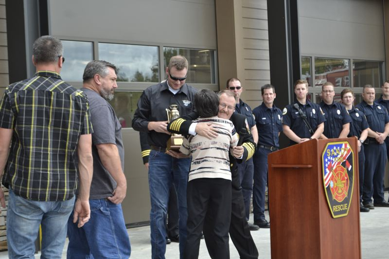 POST PHOTO: BRITTANY ALLEN - Lily Tobias, wife of the late Sandy Fire District Board chairman Len Tobias, accepted an award on his behalf in recognition of his 25-year service with the district.
