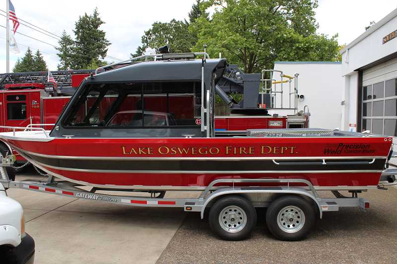 REVIEW PHOTO: ANTHONY MACUK - Lake Oswego Fire Department's new 22-foot rescue boat includes an enclosed cabin, better exterior lighting and a more powerful jet drive system. When not deployed, it sits on a trailer in the South Shore Fire Station.
