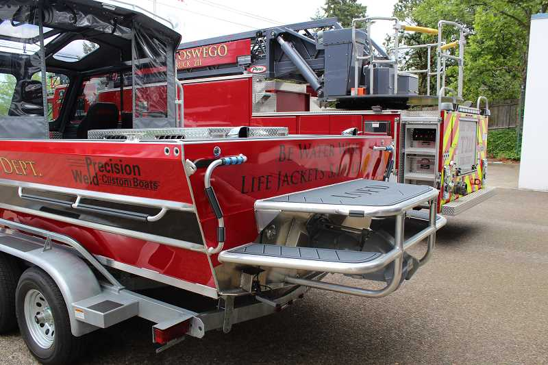 REVIEW PHOTO: ANTHONY MACUK - The new boat features a large rear platform to provide easy access for the dive team, and a pulley system for hauling people out of the water. 'Once your'e hypothermic, it gets pretty hard to help yourself in,' explains LOFD Lt. Toby Hays.