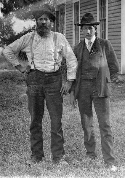 SUBMITTED PHOTO: RICK COOK - Steve and Rick Cook's great grandfather and grandfather, J.P. and William B. Cook, pose for a photo in front of the farm house circa 1900.