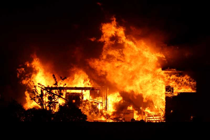 HOLLY M. GILL - A home on U.S. Highway 97, at Bear Drive, was fully engulfed in flames when firefighters arrived around 10:50 p.m. June 25.