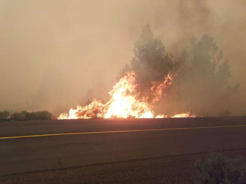 SUBMITTED PHOTO - The Graham Fire takes off along the road into the Three Rivers subdivision area, west of Lake Billy Chinook.