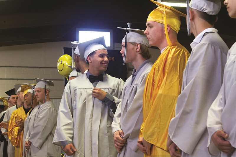 PATRICK EVANS - Graduates wait for the start of the ceremony at MacLaren Youth Correctional Facility Wednesday, June 27.