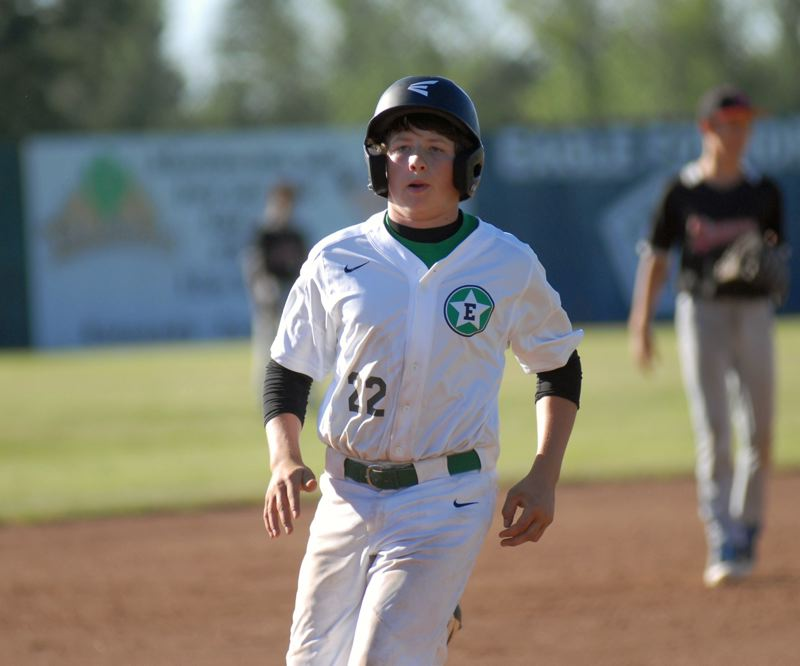 ESTACADA NEWS: MATT RAWLINGS - James Durand makes it to third base safely in Estacada's 15-2 loss to Oregon City on Tuesday.