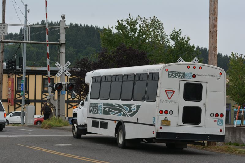 SPOTLIGHT PHOTO: COURTNEY VAUGHN - A CC Rider bus makes its way through downtown Scappoose. The bus agency will receive a $400,000 loan from Columbia County general funds to cover an end-of-year defecit.