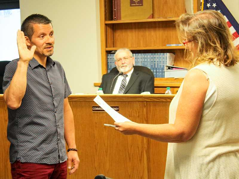 JASON CHANEY - Crook County Clerk Cheryl Seely swears in Jon Soliz as Crook County Assessor Wednesday after the Crook County Court approved his appointment to the position. Commissioner Brian Barney looks on.