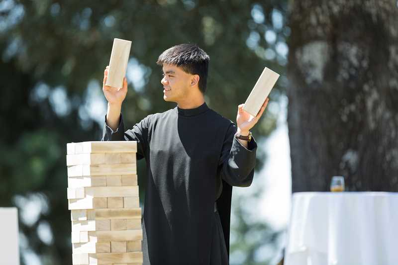 COURTESY PHOTO: MOUNT ANGEL ABBEY - Brother Anselm Flores, Order of St. Benedict, challenges all-comers to lawn jenga at last summer's St. Benedict Festival. This year, the festival is on July 7 at Mount Angel Abbey, home to a monastic community of more than 50 Benedictine monks.