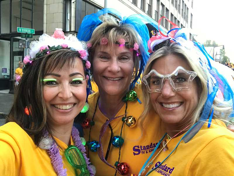SUBMITTED PHOTO - BJ Cerny, left, Julie Etzel, WHS's principal secretary and Terri Luper, parent of a student at WHS, get ready to perform in the Starlight Parade in Portland.