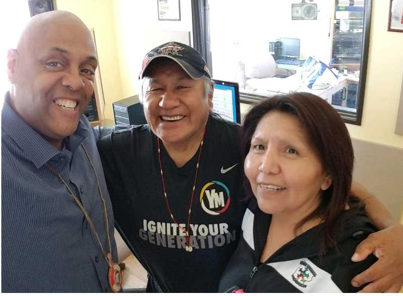 SUBMITTED PHOTO - Motivational speaker Ron James, at left, meets with Delson Suppah and Sarah Frank at KWSO in Warm Springs.