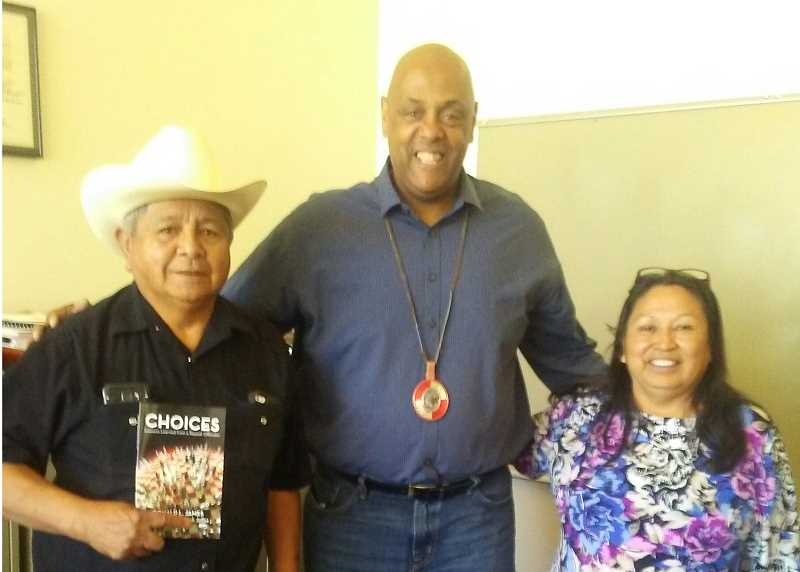 SUBMITTED PHOTO - James, who visited with the Warm Springs Tribal Council, is flanked by Tribal Council members Raymond Tsumpti and Valerie Switzler.
