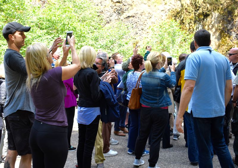 OUTLOOK PHOTO: MATT DEBOW - Visitors attempt to get a photo of former President Jimmy Carter on Thursday, June 28 at Multnomah Falls.