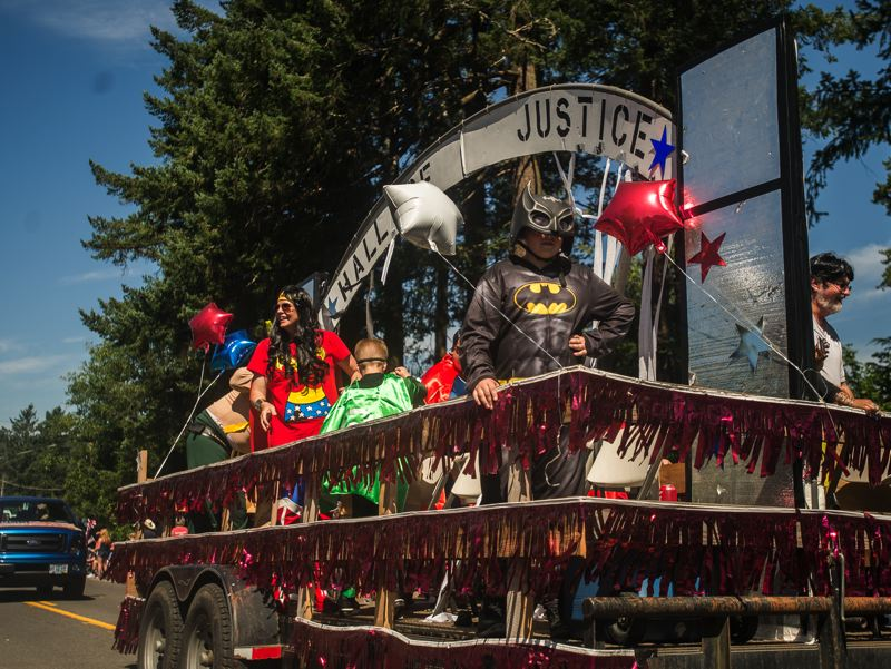 OUTLOOK FILE PHOTO - A superhero float makes its way down the parade route for last years Fourth of July celebration in Corbett.