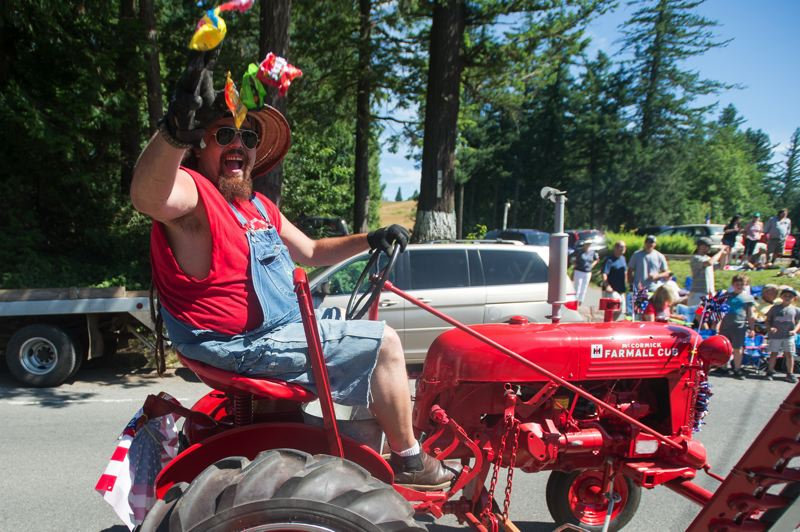 OUTLOOK FILE PHOTO - A tractor driver throws candy to parade watchers in Corbett during the annual Fourth of July parade last year.   6. Fireworks will cap off the day during the 48th annual Corbett Fun Fest on Wednesday, July 4.