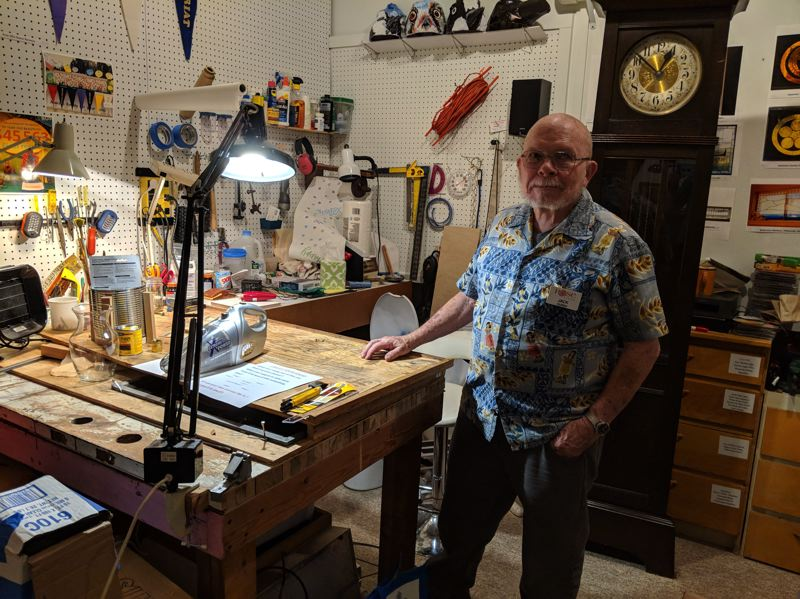 SUBMITTED PHOTO - Leaded-glass artist Jack Duren explains his new project that incorporates a handheld vacuum and public participation.