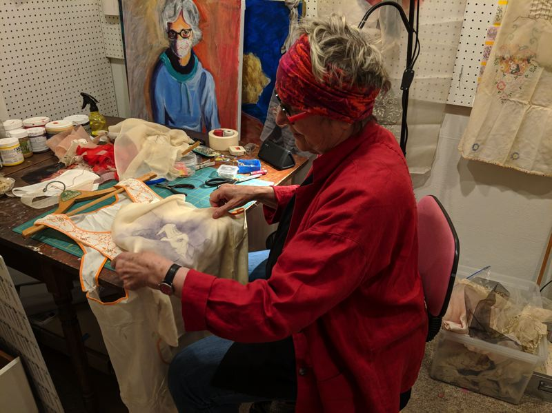 SUBMITTED PHOTO - Rose Villa artist Ruth Ross works on monotype printmaking on vintage fabrics.