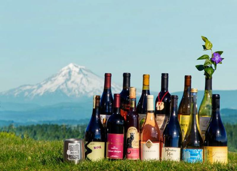SUBMITTED PHOTO - A Mt. Hood Territory Wine Trail stainless steel cup is pictured next to Clackamas County wines.