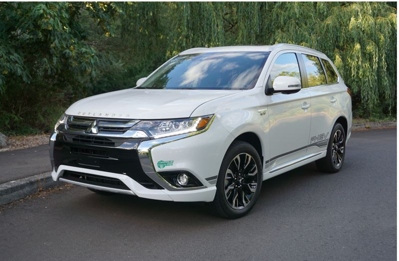 PORTLAND TRIBUNE: JEFF ZURCHMEIDE - The 2018 Mitsubishi PHEV is one of the few plug-in hybrids with all-wheel-drive. It will go up to 22 miles on electricity alone before the 2.0-liter gas engine kick in to extend the range and provide additional traction when needed.