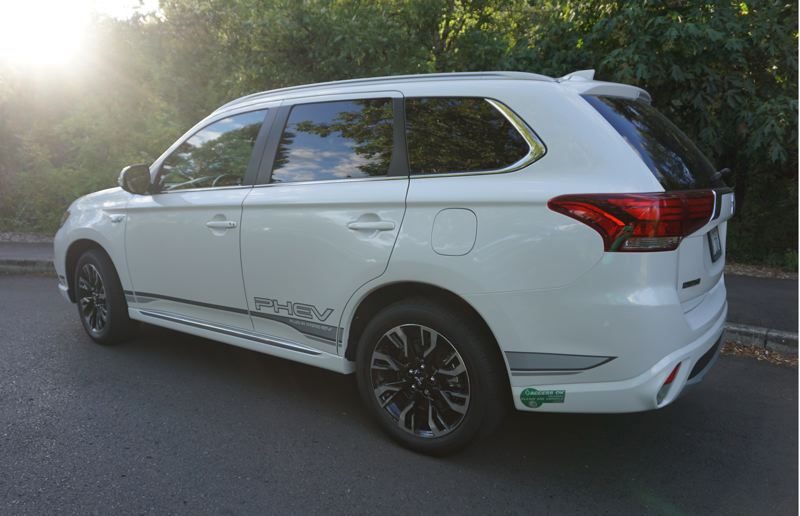 PORTLAND TRIBUNE: JEFF ZURSCHMEIDE - The styling on the 2018 Outlander PHEV is clean and contemporary, and the PHEV decals are optional if you do not feel the need to advertise your green cred.