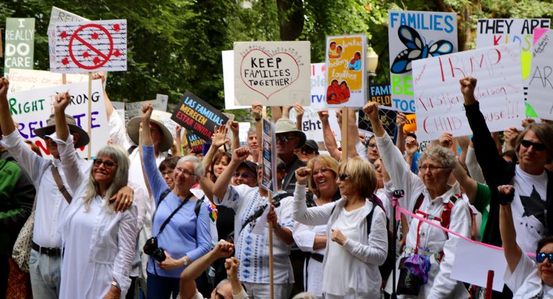 TRIBUNE PHOTO: ZANE SPARLING - Protesters raise their fists during the 'Families Belong Together' rally on Saturday, June 30 in Portland.