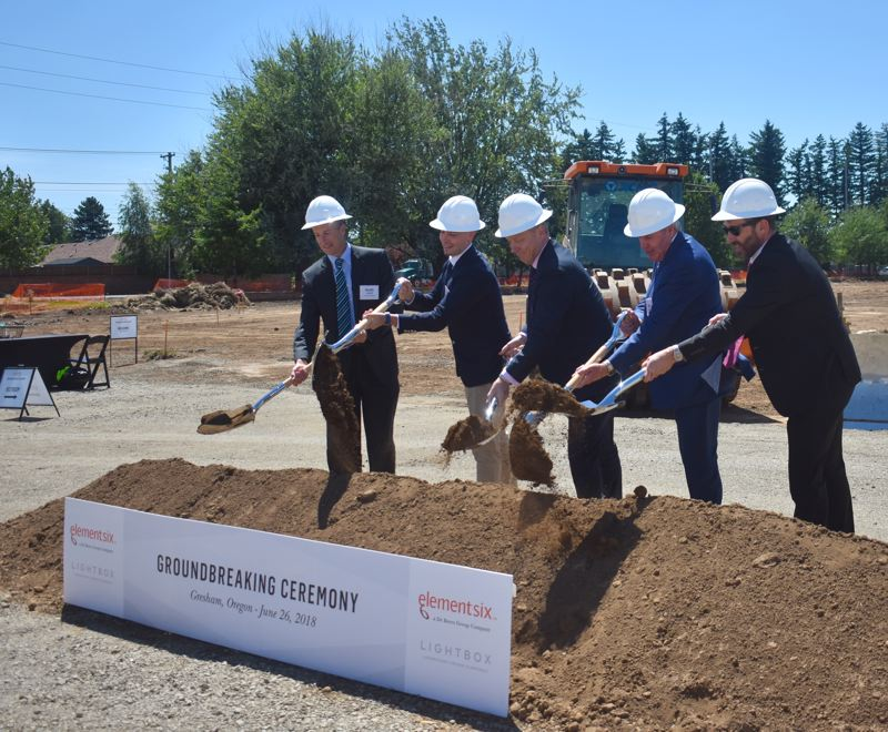 HAILEY STEWART - Element Six, Lightbox and Gresham leaders break ground at the site of the new facility coming next August.