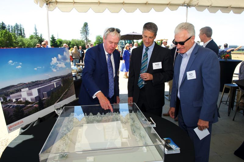 COURTESY: ELEMENT SIX - Element Six Global Operations Director Ken Sullivan shows a model of the facility to ground breaking attendees.