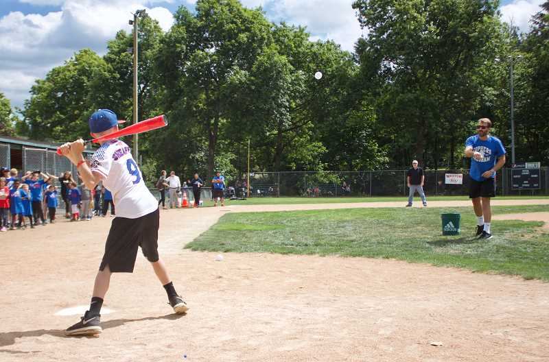 OUTLOOK PHOTO: CHRISTOPHER KEIZUR - Gresham Mayor Shane Bemis pitched to all of the kids who visited Main City Park on Thursday afternoon, June 28.