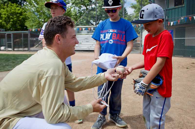 OUTLOOK PHOTO: CHRISTOPHER KEIZUR - Gresham GreyWolves pitcher Jack Gordon signed a baseball for a young fan during the event.