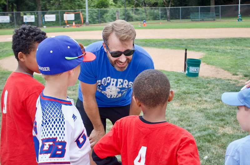 OUTLOOK PHOTO: CHRISTOPHER KEIZUR - Mayor Shane Bemis spoke with all of the kids before pitching to them at Play Ball Gresham.