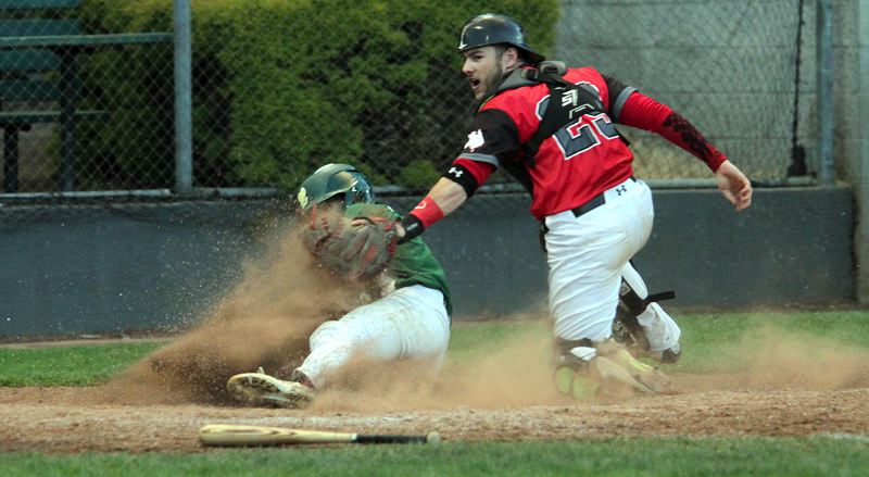 TIDINGS PHOTO: MILES VANCE - West Linn's Caden Parker slides past Perth catcher Nick Hurst to score in the sixth inning of the Lions' 5-4 loss in the championship game of the Firecracker Classic at Lakeridge High School on Sunday.