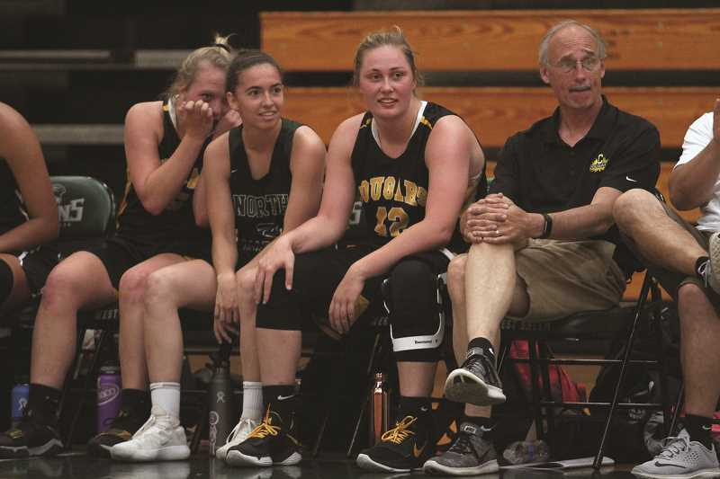 PHIL HAWKINS - After spending the last four years competing against the league-rival Cascade Cougars, North Marion's Ally Umbenhower (middle left) teamed up with the Cougars' Kelsey Molan (left), Halle Wright (middle right) and head coach Mark Stevens on the 2018 West All-Star team.