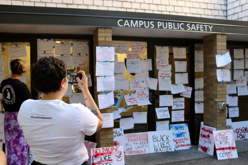 TRIBUNE PHOTO: ZANE SPARLING - Signs decrying the death of Jason Washington were posted outside the Campus Public Safety building on Southwest Montgomery Street on Sunday, July 1 at Portland State University.