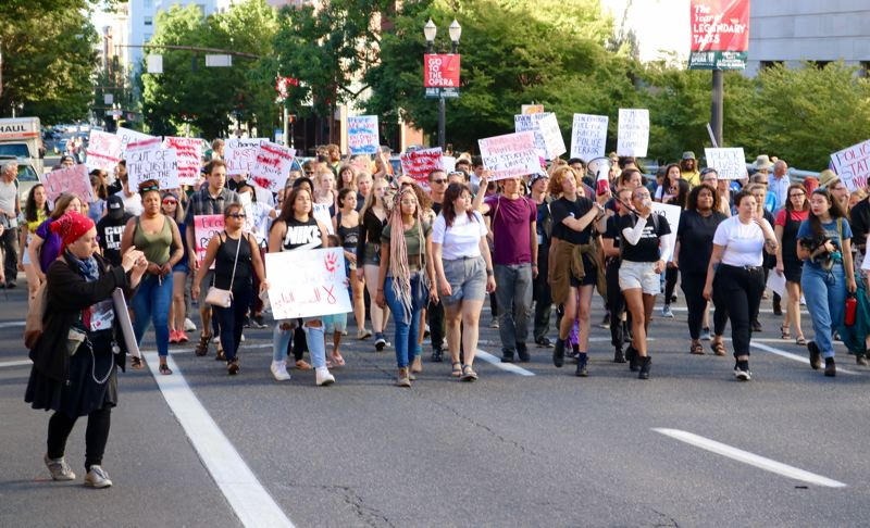 TRIBUNE PHOTO: ZANE SPARLING - A crowd of several hundred, lead by the Portland State University Student Union, marched down Southwest Broadway on Sunday, July 1 in Portland.