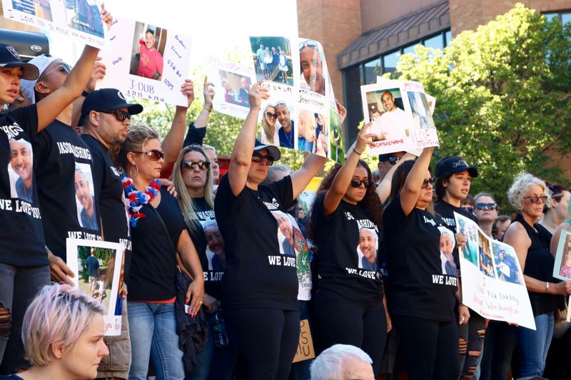 TRIBUNE PHOTO: ZANE SPARLING - Family members and friends hold signs on the steps of Pioneer Courthouse Square on Sunday, July 1 during a rally honoring the death of Jason Washington.