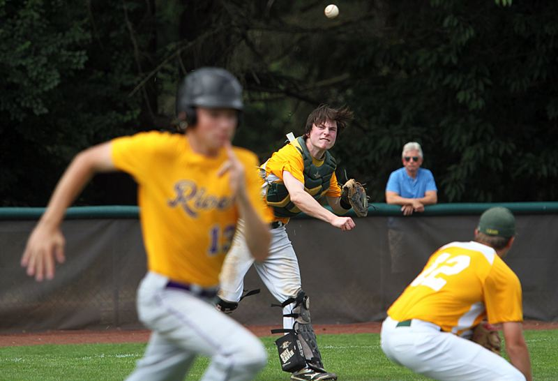 TIDINGS PHOTO: MILES VANCE - West Linn catcher Garrett Wiancko throws to first base during his team's 8-5 loss to Columbia River in pool play action at the Firecracker Classic at Lakeridge High Schoolon Saturday.